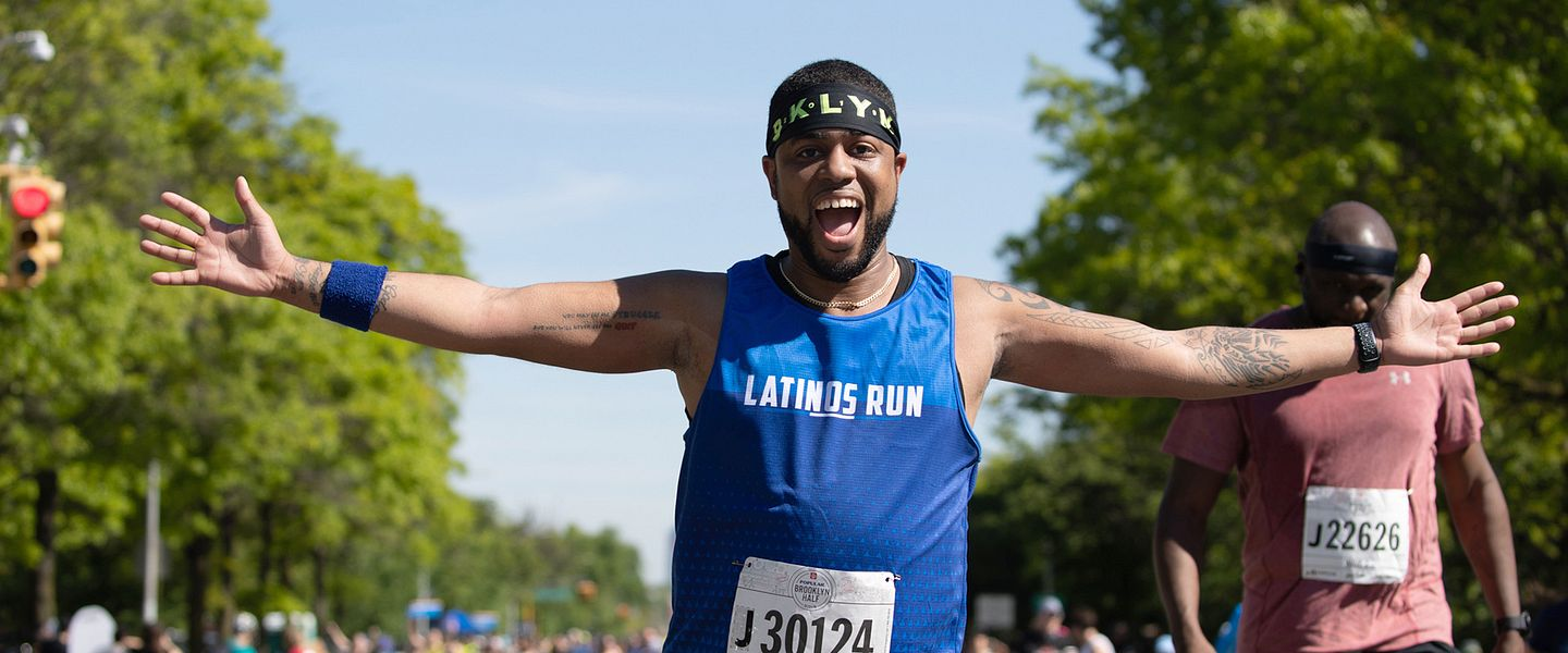 Antonio Quinones grins and extends his arms as he runs