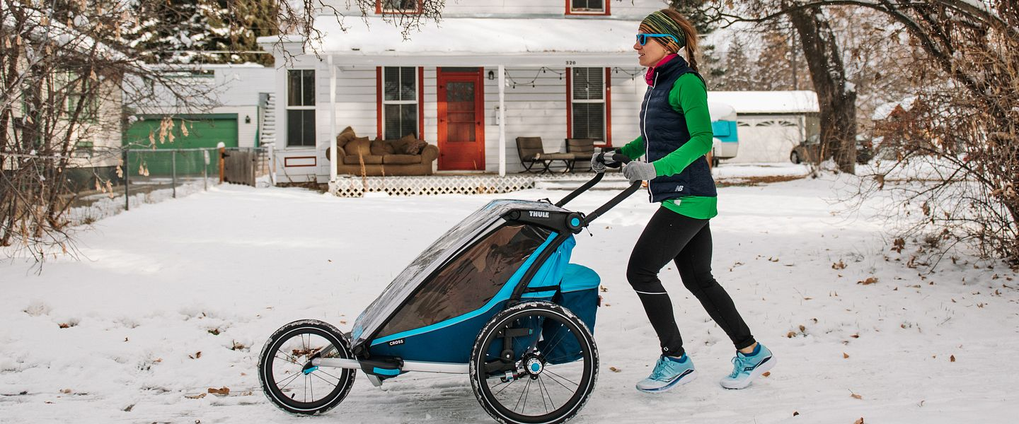 Lauren Arnold runs with a stroller in snow