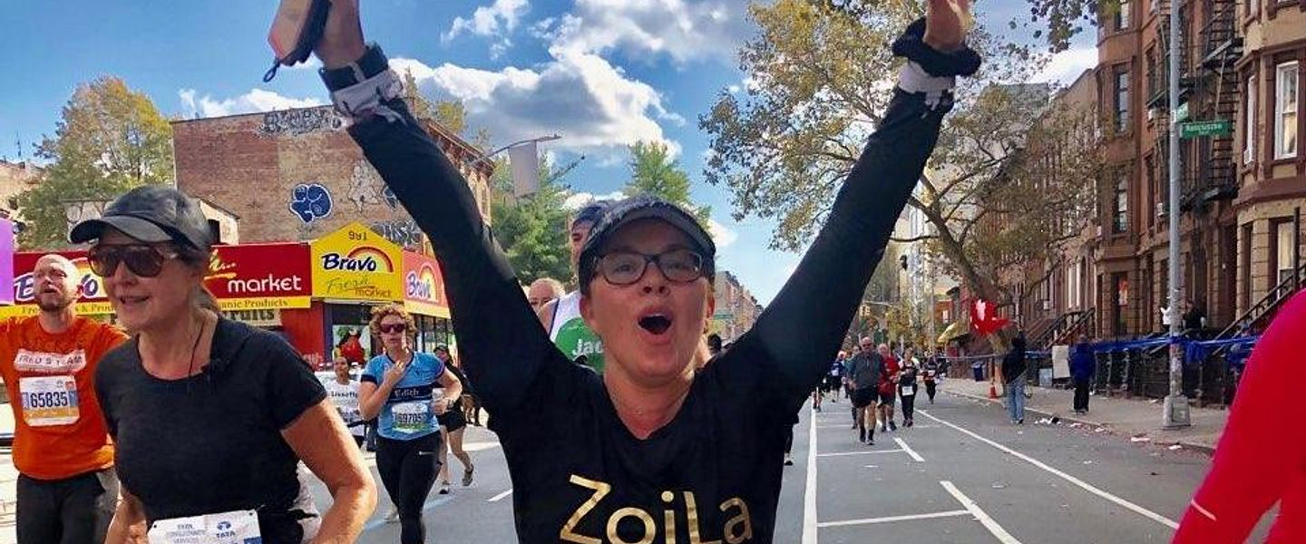 Zoilabella Calo Smiles and holds out her arms as she runs