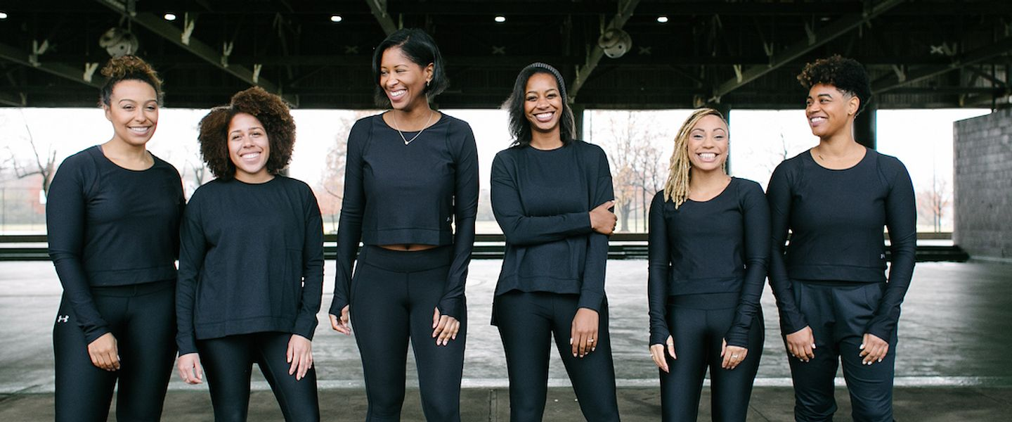 The six co-founders of RUNGRL stand side by side, smiling