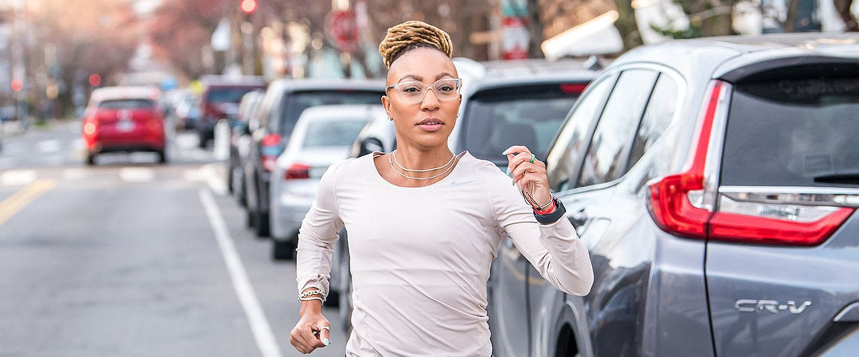 A woman runs alone on a street