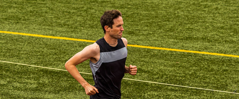 ASICS runner Johnny Gregorek runs on a track